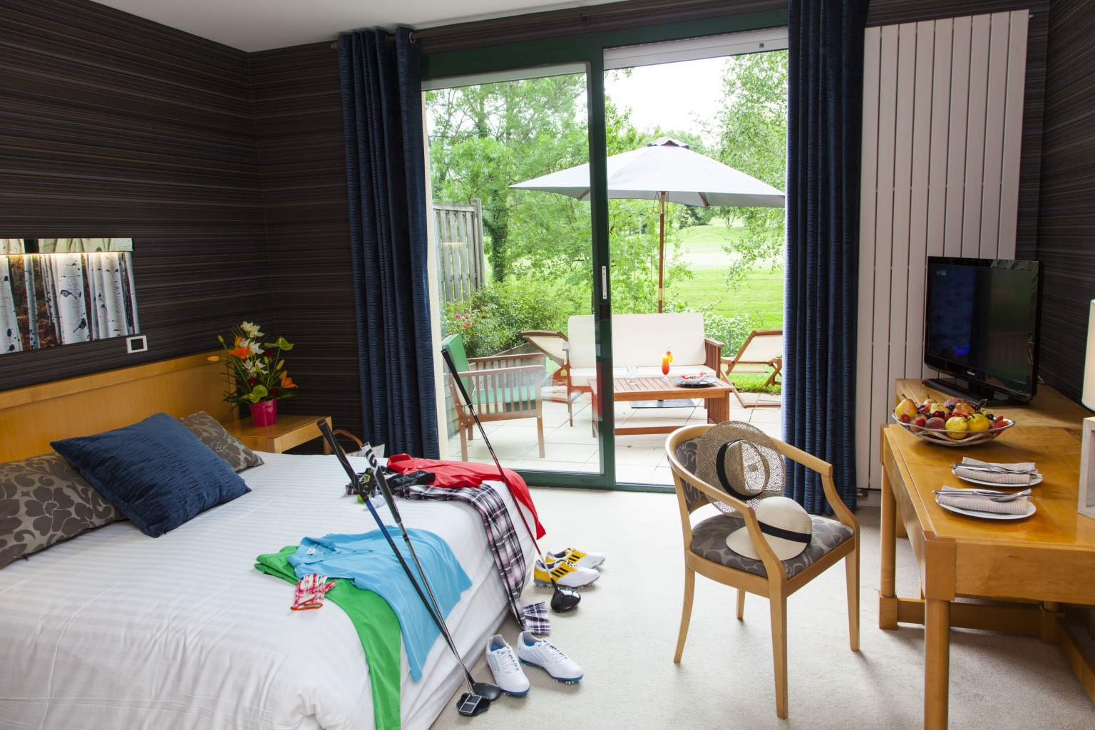 Room with window and golf equipment